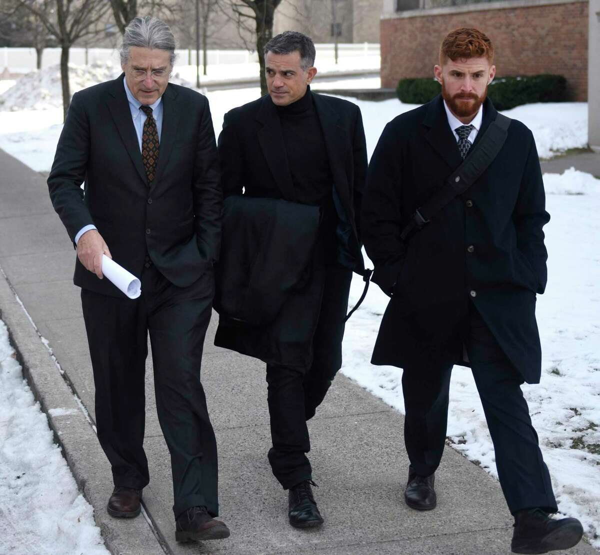 Fotis Dulos, center, leaves after his murder case hearing with attorneys Norm Pattis, left and Chris La Tronica at Connecticut Superior Court in Stamford, Conn. Thursday, Jan. 23, 2020.