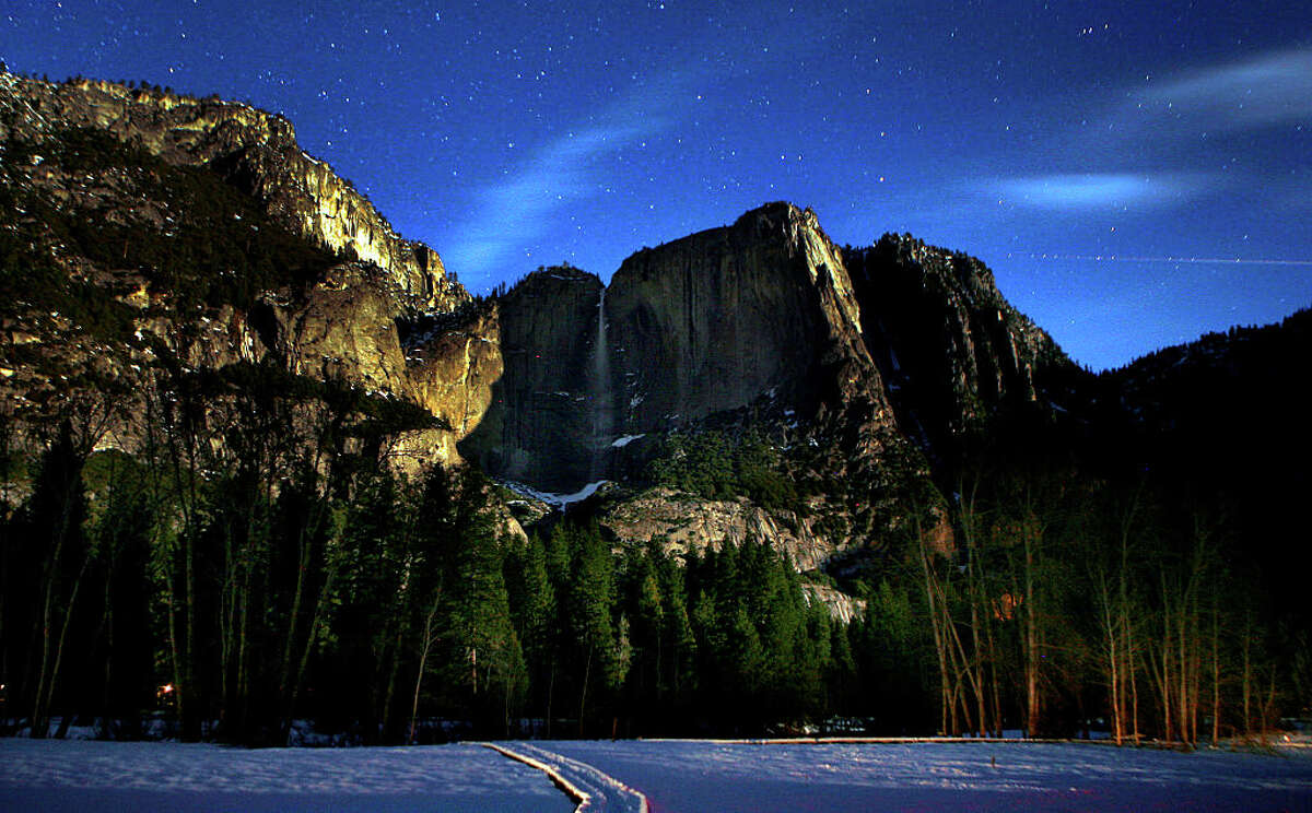 The granite faces of the Yosemite Valley are illuminated by the stars and the moon on a clear in January, 2010.