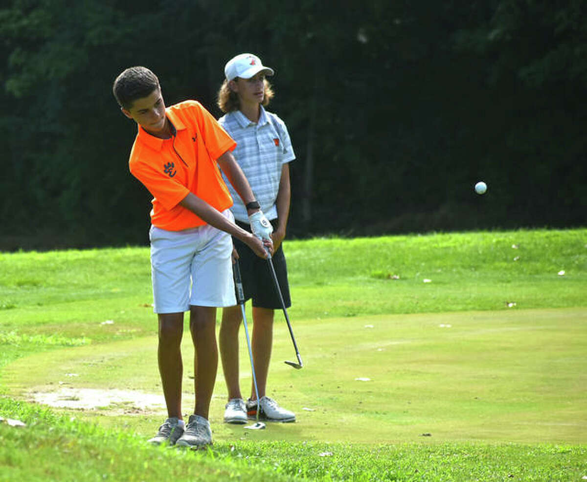 Edwardsville's Drew Suhre chips onto the green on No. 9 at Fox Creek during the Dick Gerber Invitational.