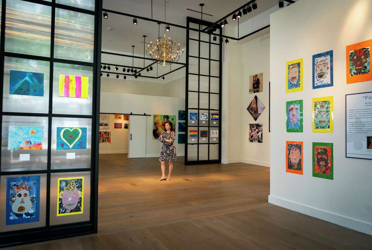 """KNOWAustim Foundation founder Tammy Tran Nguyen stands in the """"As I Am"""" art program display, Tuesday, Aug. 24, 2021, in a gallery space at the River Oaks District in Houston. She founded the foundation in 2013 after her son, Reagan, was diagnosed with autism. The gallery is open to the public through September 12. Proceeds from the gallery go toward KNOWAutism's mission of assisting families with children impacted by autism to navigate the process of diagnostics, treatment, intervention and education."""