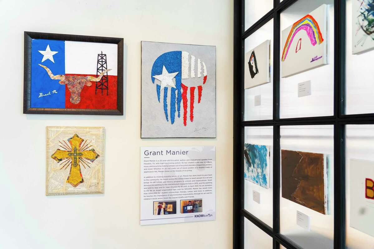 """Pieces by artist Grant Manier hang on the wall as part ofthe KNOWAustim Foundation's """"As I Am"""" art program on display, Tuesday, Aug. 24, 2021, in a gallery space at the River Oaks District in Houston. The gallery is open to the public through September 12. Proceeds from the gallery go toward KNOWAutism's mission of assisting families with children impacted by autism to navigate the process of diagnostics, treatment, intervention and education."""