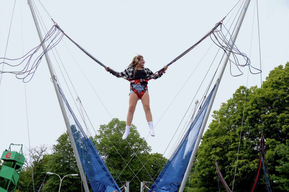 Maggie Casey, 11, of Ridgefield, flys high on the bungee trampoline at Ridgefield Parks & Recreation Department's End of Summer Rec Party.