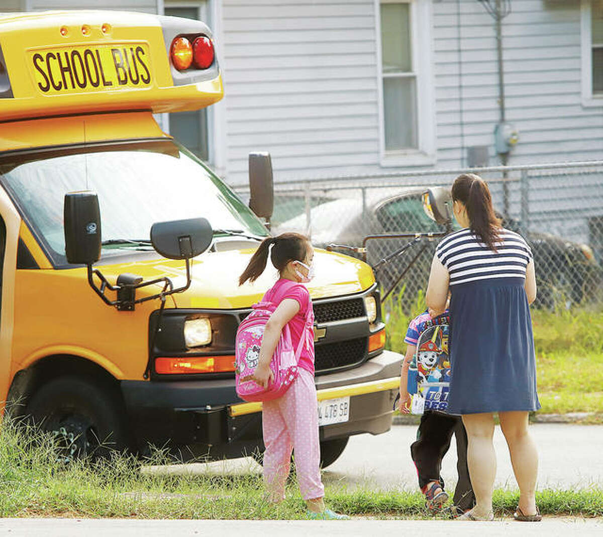 With crowds still limited by the COVID-19 delta variant, schools have become a good place to see the increasing diversity in the Riverbend, such as this family meeting a school bus in Alton on Seminary Street.