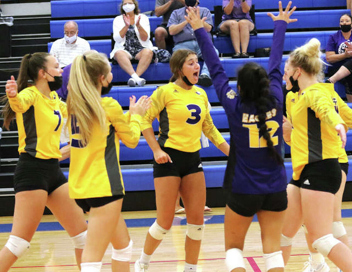 CM's Maddie Brueckner (3) celebrates a point with teammates during pool play Tuesday at the Roxana Tourney. CM came back Saturday to win the tourney title, with Brueckner earning all-tournament recognition.