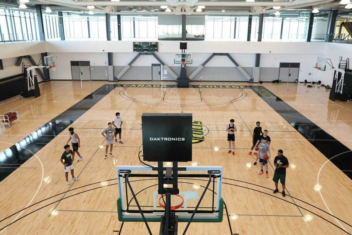 Members of the Cañada College men's basketball team practice in the gym in the new $120 million Kinesiology and Wellness Building in Redwood City.