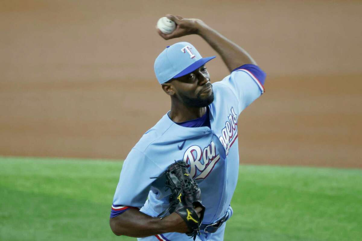 Texas Rangers starting pitcher Taylor Hearn throws against the Houston Astros during the first inning of a baseball game Sunday, Aug. 29, 2021, in Arlington, Texas. (AP Photo/Michael Ainsworth)