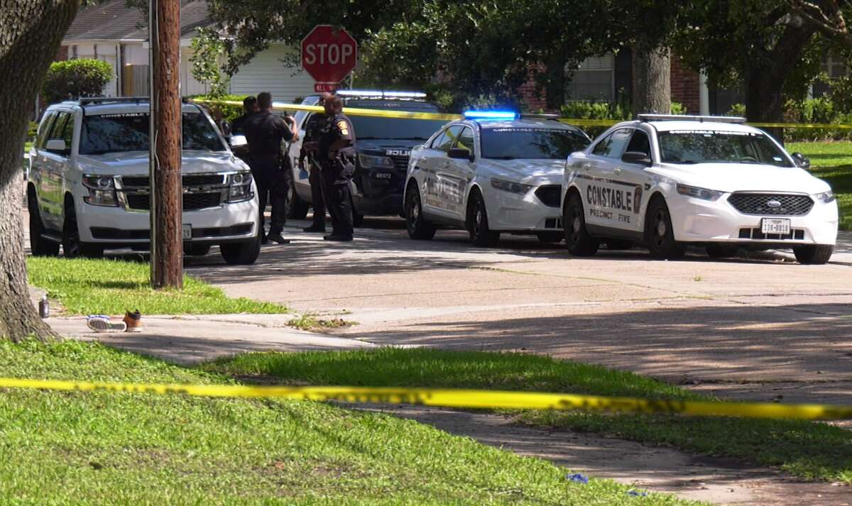 Police at the scene where a knife-wielding suspect was shot by a Precinct 5 deputy Aug. 29, 2021, in the 10300 block of Mullins Drive.