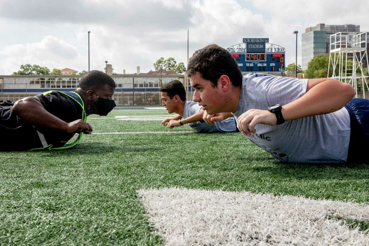 Retired Army Captain Dwayne Rhodes is the JROTC Senior Army Instructor at Central Catholic High School. Part of that job is leading his students in physical training on the football field.