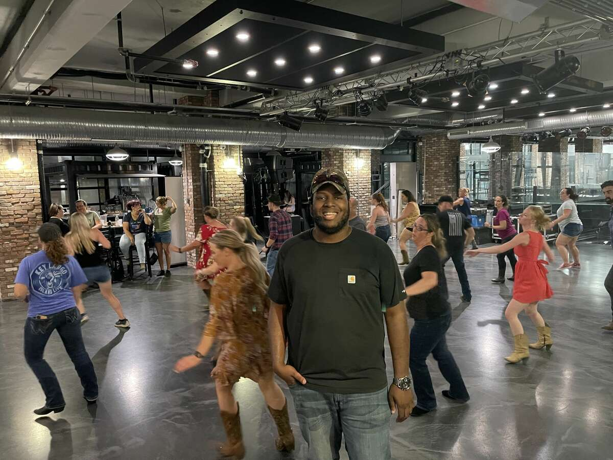 Aaron Dritz, founder and dance director of Aaron's 'A' Team of Line Dancers, hosts a weekly line dancing class at Frog Alley Brewing in Schenectady.
