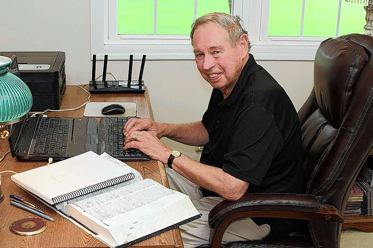 """Taylor Pensoneau in his New Berlin home office at work on his next book, """"Corruption Incorporated."""""""