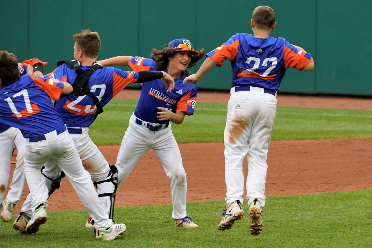 The Taylor, Mich., Little League team celebrates after getting the final out of the Little League World Series Championship baseball game against Hamilton, Ohio, in South Williamsport, Pa., Sunday, Aug. 29, 2021. Michigan won 5-2. (AP Photo/Gene J. Puskar)