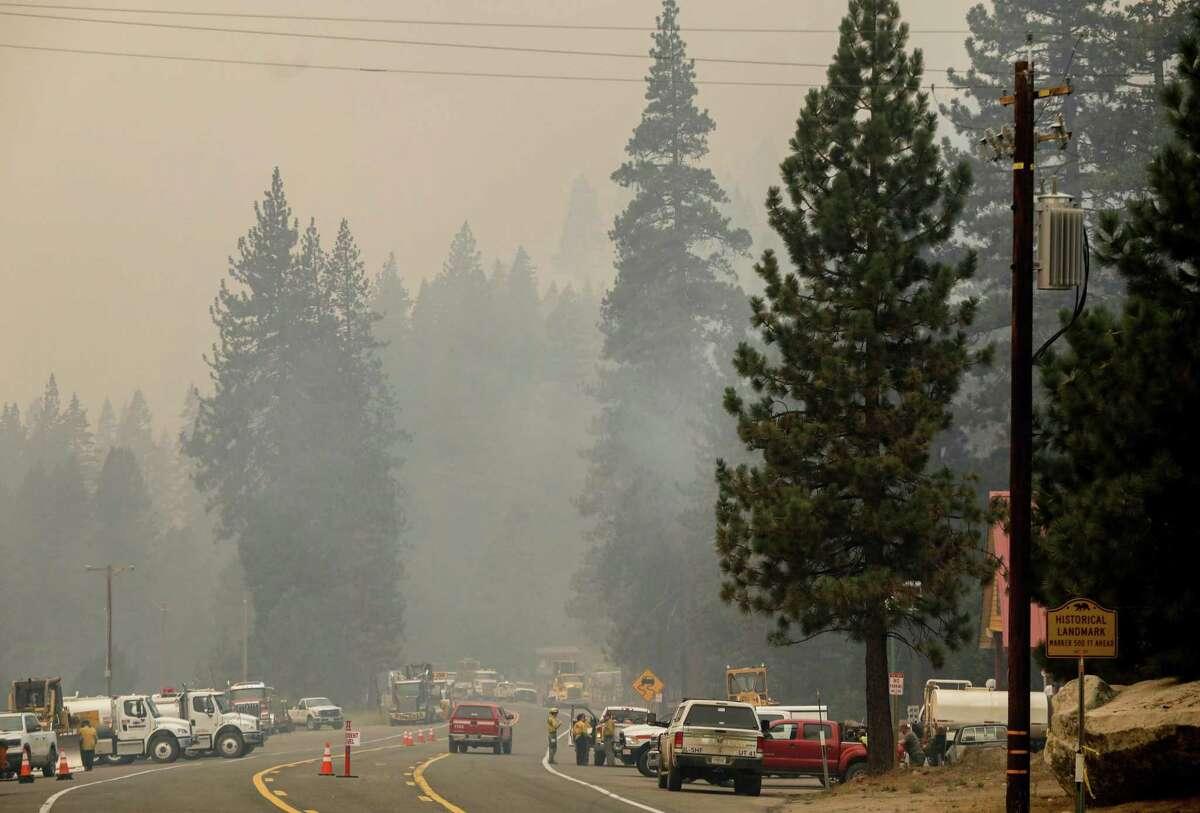 Fire crews gather near Strawberry Lodge as the Caldor Fire burns in El Dorado County.