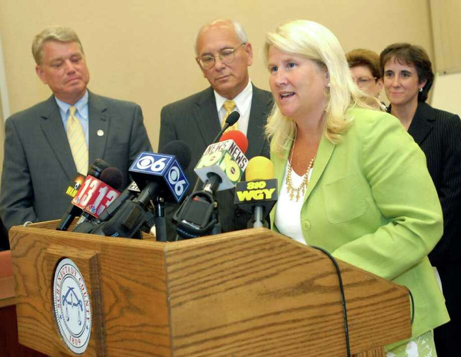 Susan Savage, chairwoman of Schenectady County Legislature is defending a campaign ad touting her role in bringing jobs to Schenecatdy. In this photo, Savage, right, speaks during the official announcement that Schenectady will be the site of General Electric Advanced Battery Manufacturing Center on Wednesday, Aug. 5, 2009, at the Schenectady County Building in Schenectady, N.Y. Joining her are Mayor Brian Stratton, left, U.S. Rep. Paul Tonko, center, and Chris Horne of GE Energy, far right. (Cindy Schultz / Times Union archive) Photo: CINDY SCHULTZ / 00005010A