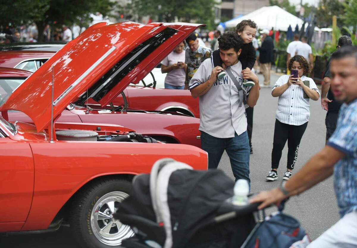 Cars are on display at the Cruising Stamford Car Show at Columbus Park in Stamford, Conn. Sunday, Aug. 29, 2021. Synergy1Holdings and BlackRoads Auto Club presented the free show, showcasing vintage to early-'80s classic cars.