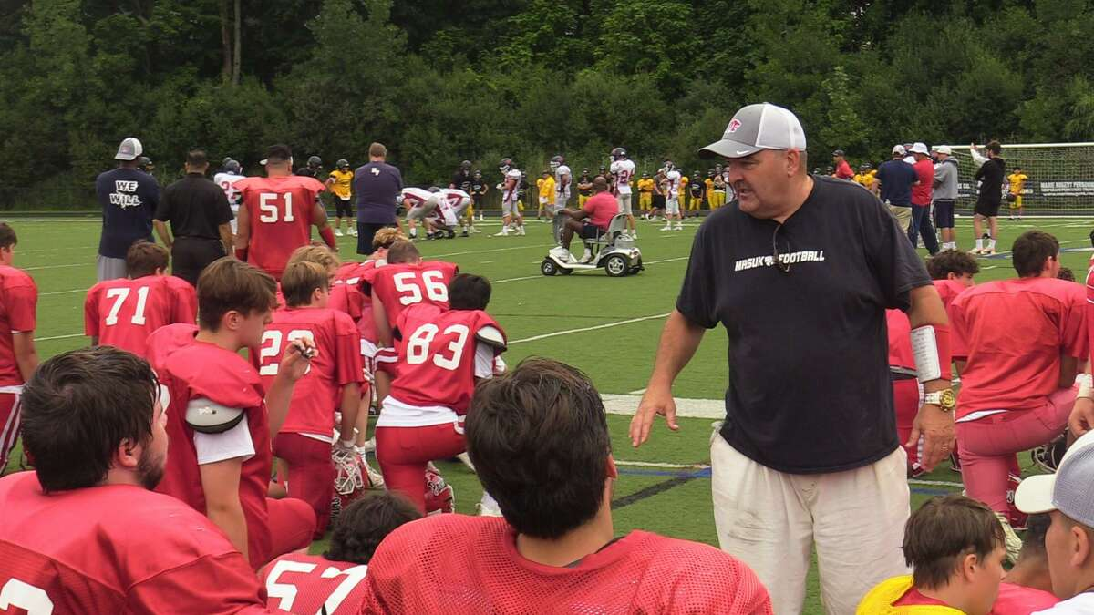 Masuk coach Steve Christy addresses his during Saturday's scrimmage jamboree at Immaculate.