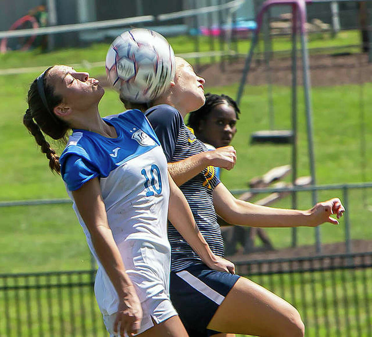 """Lewis and Clark""""s Grace Osvath (10) tries to win possession of the ball against Johnson County's Haliina Williamson Sunday at LCCC. Johnson County defeated the Trailblazers 2-0."""