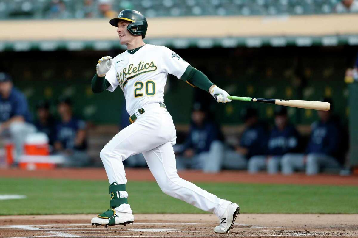 Oakland Athletics' Mark Canha singles in 1st inning against Seattle Mariners during MLB game at Oakland Coliseum in Oakland, Calif., on Monday, August 23, 2021. Canha would eventually score on Yan Gomes' ground out.