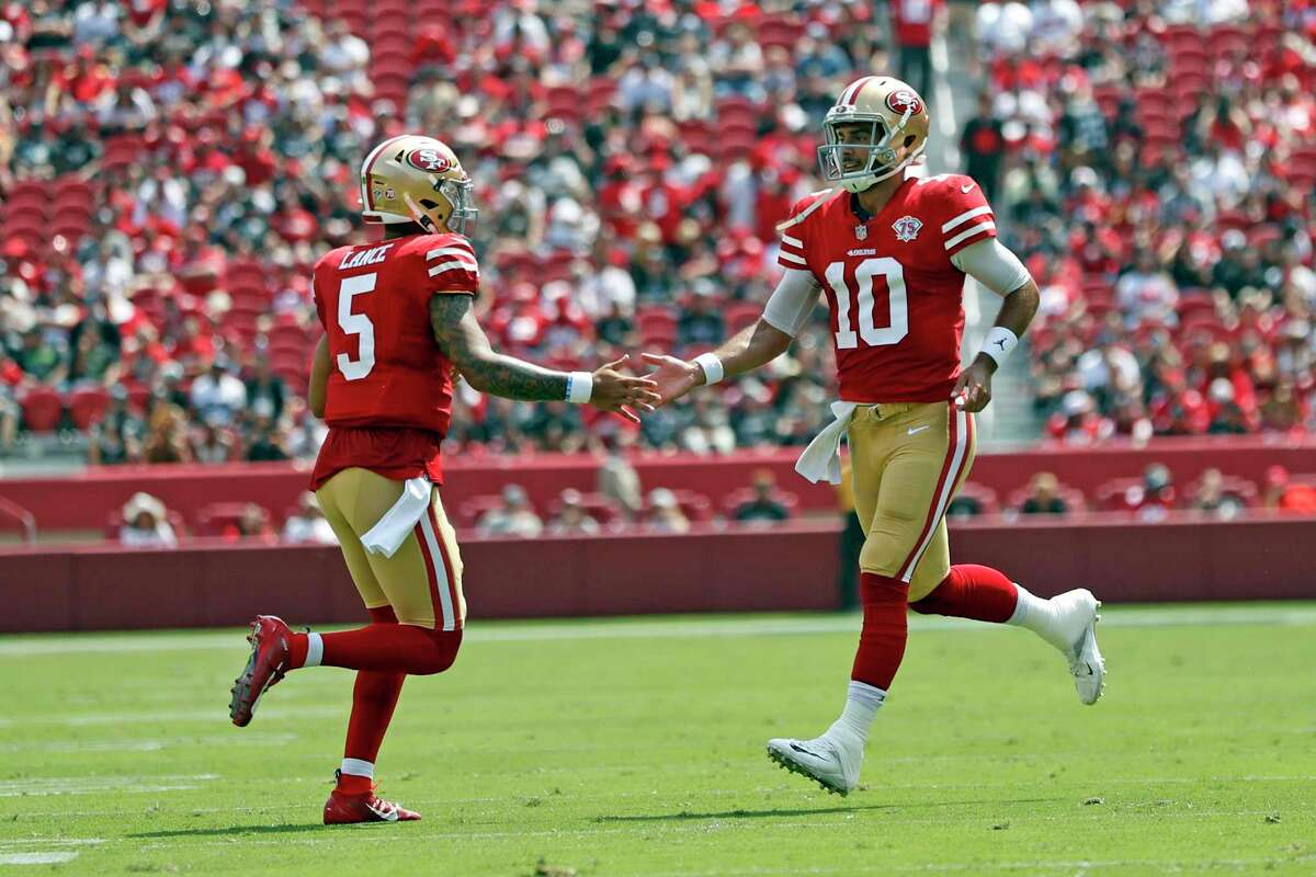 San Francisco 49ers' quarterbacks Jimmy Garoppolo and Trey Lance switch in and out in 2nd quarter against Las Vegas Raiders during NFL preseason game at Levi's Stadium in Santa Clara, Calif., on Sunday, August 29, 2021.