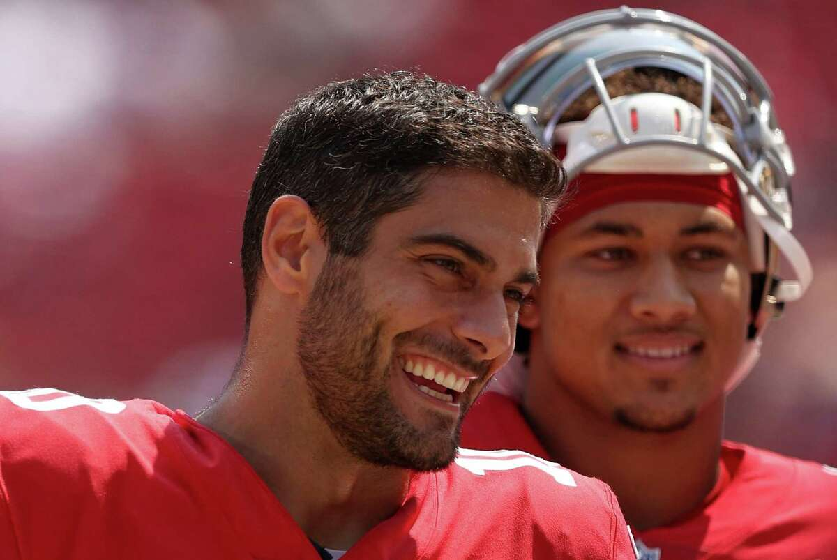 Jimmy Garoppolo #10 and Trey Lance #5 of the San Francisco 49ers talk to each other on the sidelines before their preseason game against the Las Vegas Raiders at Levi's Stadium on August 29, 2021 in Santa Clara, California. (Photo by Ezra Shaw/Getty Images)