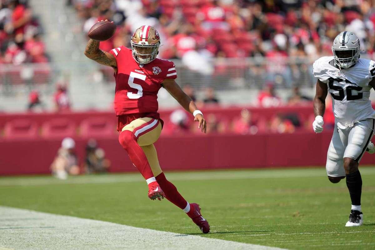 San Francisco 49ers quarterback Trey Lance (5) runs out of bounds against the Las Vegas Raiders during the first half of an NFL preseason football game in Santa Clara, Calif., Sunday, Aug. 29, 2021. (AP Photo/Tony Avelar)