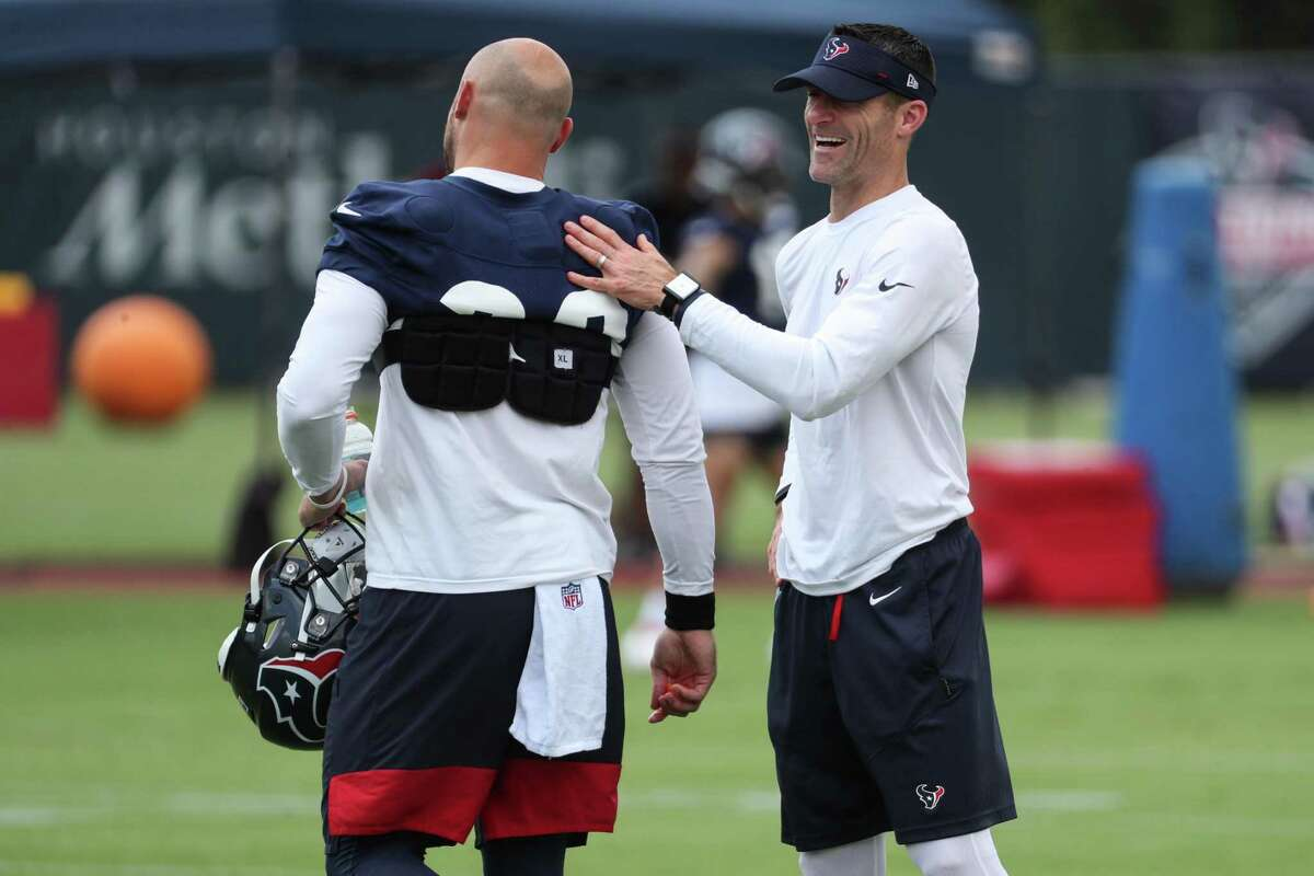 Texans GM Nick Caserio, with running back Rex Burkhead during camp, said the Texans took the first step to establishing a new culture.