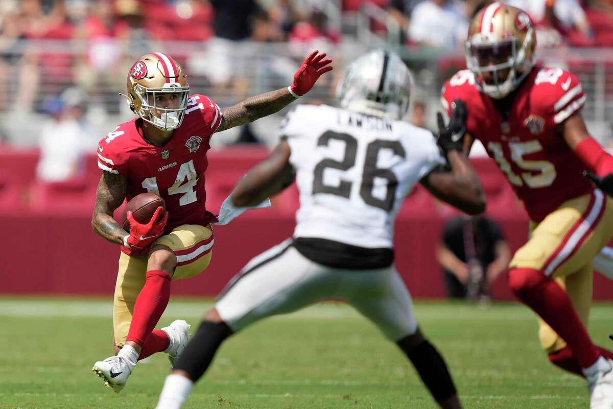 San Francisco 49ers wide receiver Jalen Hurd (14) runs against the Las Vegas Raiders during the first half of an NFL preseason football game in Santa Clara, Calif., Sunday, Aug. 29, 2021. (AP Photo/Tony Avelar)
