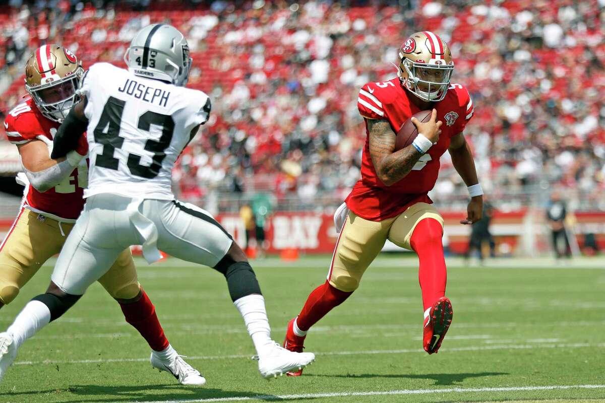 San Francisco 49ers' Trey Lance scores a 2nd quarter rushing touchdown against Las Vegas Raiders during NFL preseason game at Levi's Stadium in Santa Clara, Calif., on Sunday, August 29, 2021.