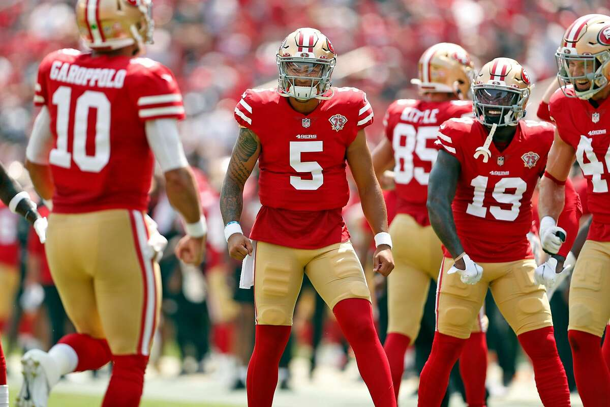 San Francisco 49ers' Trey Lance and Deebo Samuel wait to congratulate Jimmy Garoppolo after Garoppolo's 1st quarter rushing touchdown against Las Vegas Raiders during NFL preseason game at Levi's Stadium in Santa Clara, Calif., on Sunday, August 29, 2021.