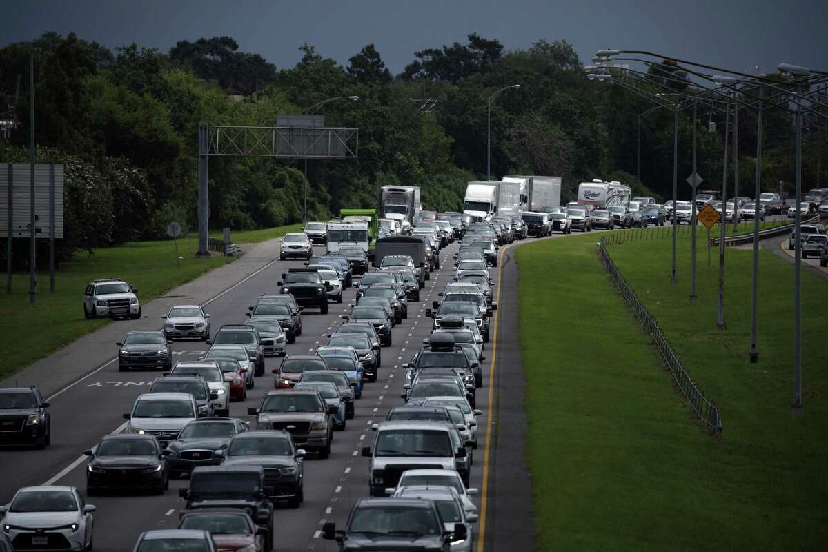 Motorists sit in traffic on I-10 West while evacuating ahead of Hurricane Ida in Metairie, Louisiana, U.S., on Saturday, Aug. 28, 2021. Hurricane Ida is growing in size and power as it moves north across the Gulf of Mexico toward Louisiana, and New Orleans is bracing for disaster -- clearing out hospital wards, shutting down oil refineries and forcing residents of low-lying neighborhoods to flee. Photographer: Luke Sharrett/Bloomberg