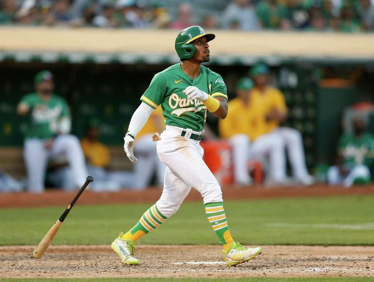 Tony Kemp smashes a two-run home run in the bottom of the eighth inning at RingCentral Coliseum.