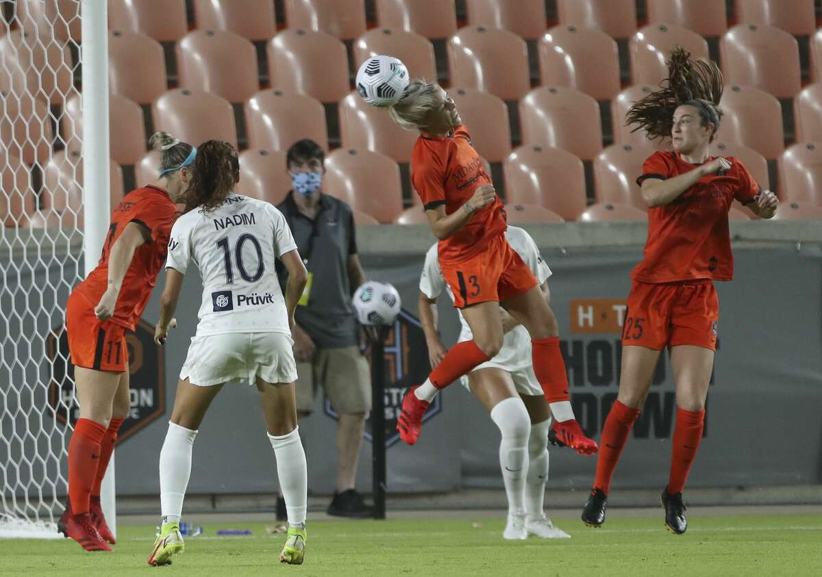 Houston Dash forward Rachel Daly (3) clears a against the Racing Louisville FC corner kick during the second half of the NWSL match Sunday, Aug. 29, 2021, at BBVA Stadium in Houston. Houston Dash defeated Racing Louisville FC 1-0.