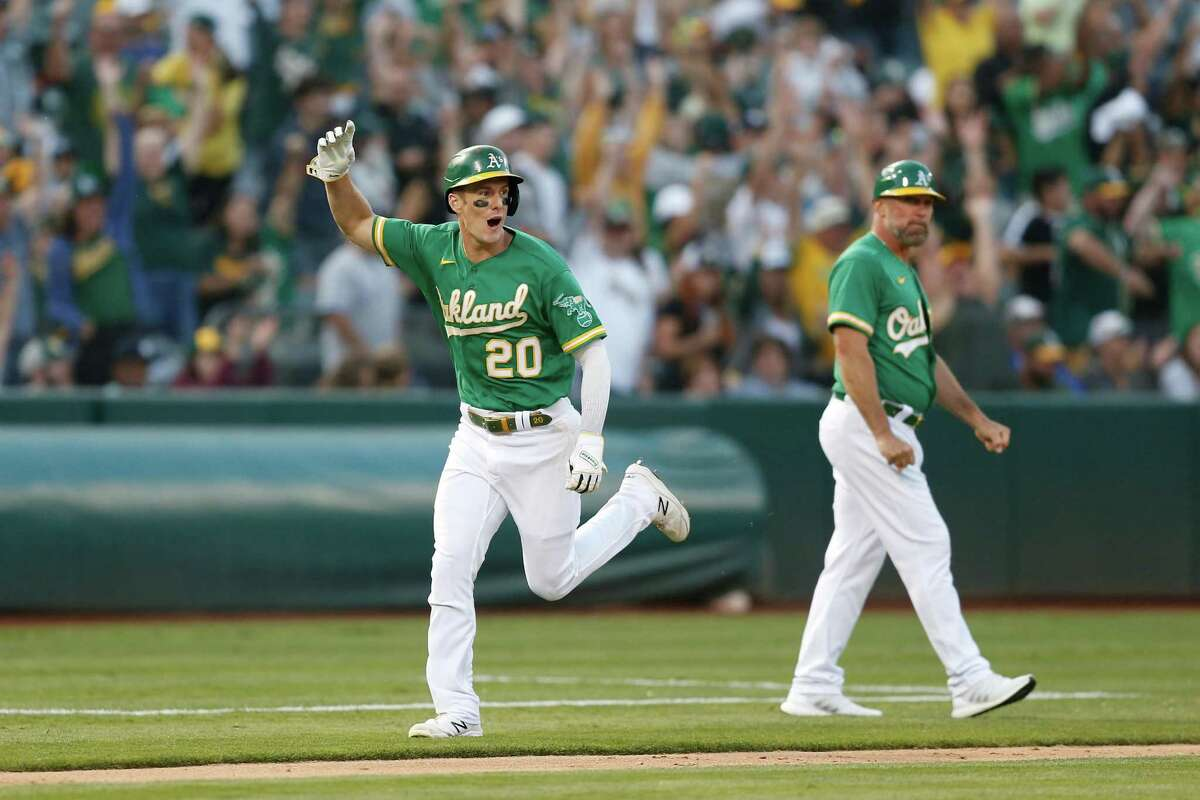OAKLAND, CALIFORNIA - AUGUST 29: Mark Canha #20 of the Oakland Athletics celebrates as he rounds the bases to score on a two-run home run by Tony Kemp #5 in the bottom of the eighth inning against the New York Yankees at RingCentral Coliseum on August 29, 2021 in Oakland, California. (Photo by Lachlan Cunningham/Getty Images)