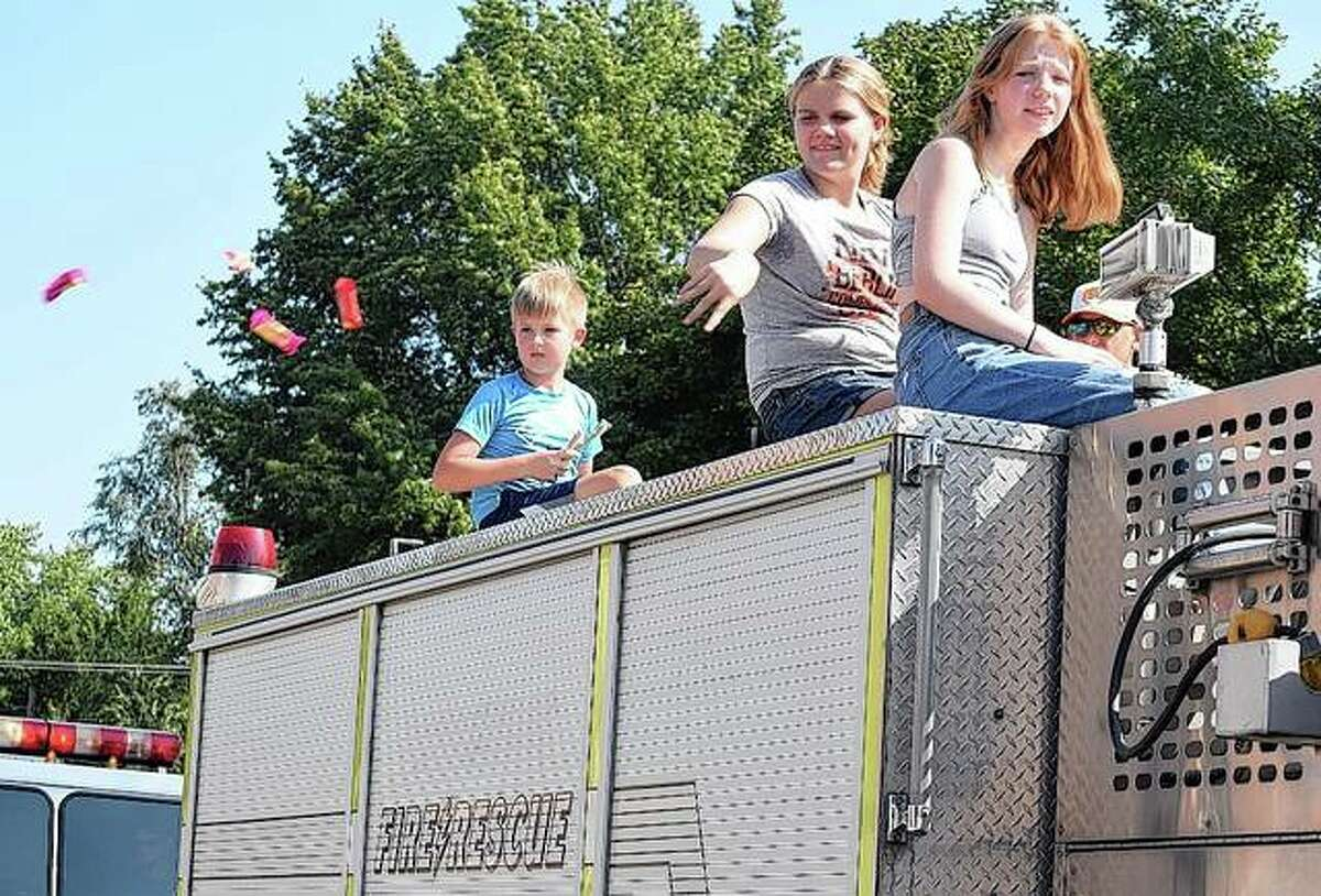 A group throws candy from a Loami Fire Department truck Saturday to those who turned out to watch a parade that was part of Waverly Picnic events. More photos are available online at myjournalcourier.com.
