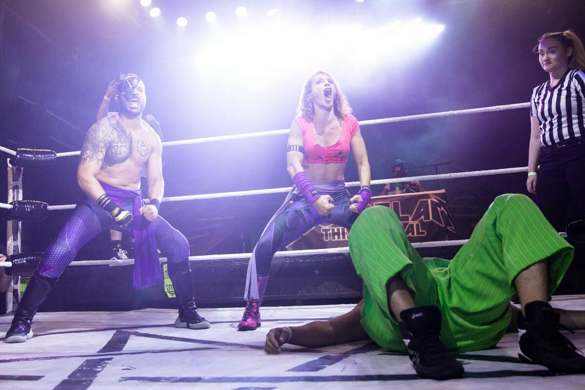 """Left to right, the """"LINK to the Future"""" Anton Voorhees and Dark Sheik (Hoodslam founder Sam Khandaghabadi) flex their muscles during Hoodslam's return at DNA Lounge in San Francisco on Aug. 22, 2021."""