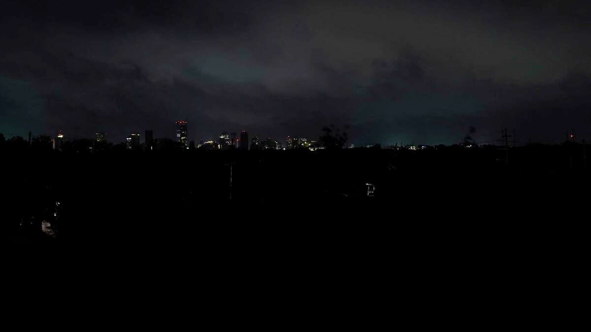 Downtown buildings relying on generator power are seen as the entire city of New Orleans is without power in the aftermath of Hurricane Ida in New Orleans, Monday, Aug. 30, 2021.