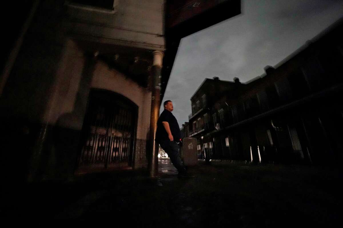 Greg Nazarko, manager of the Bourbon Bandstand bar on Bourbon Street, leans against a pole outside the club where he rode out Hurricane Ida that knocked out power in New Orleans, Monday, Aug. 30, 2021.