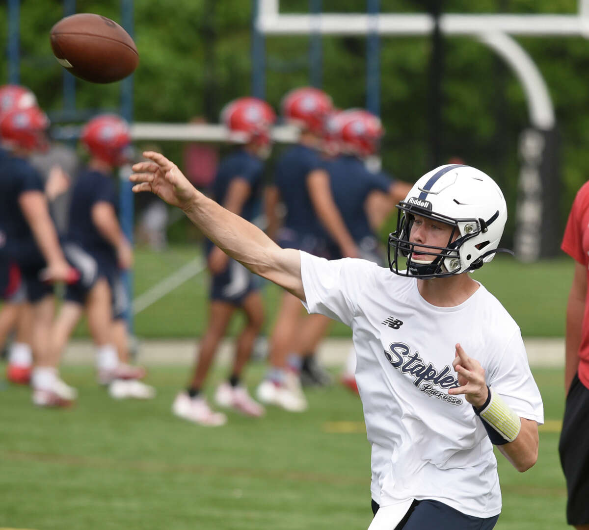 Staples' quarterback Ryan Thompson throws a pass during day two of the Grip It and Rip It football tournament in New Canaan on Saturday, July 10, 2021.
