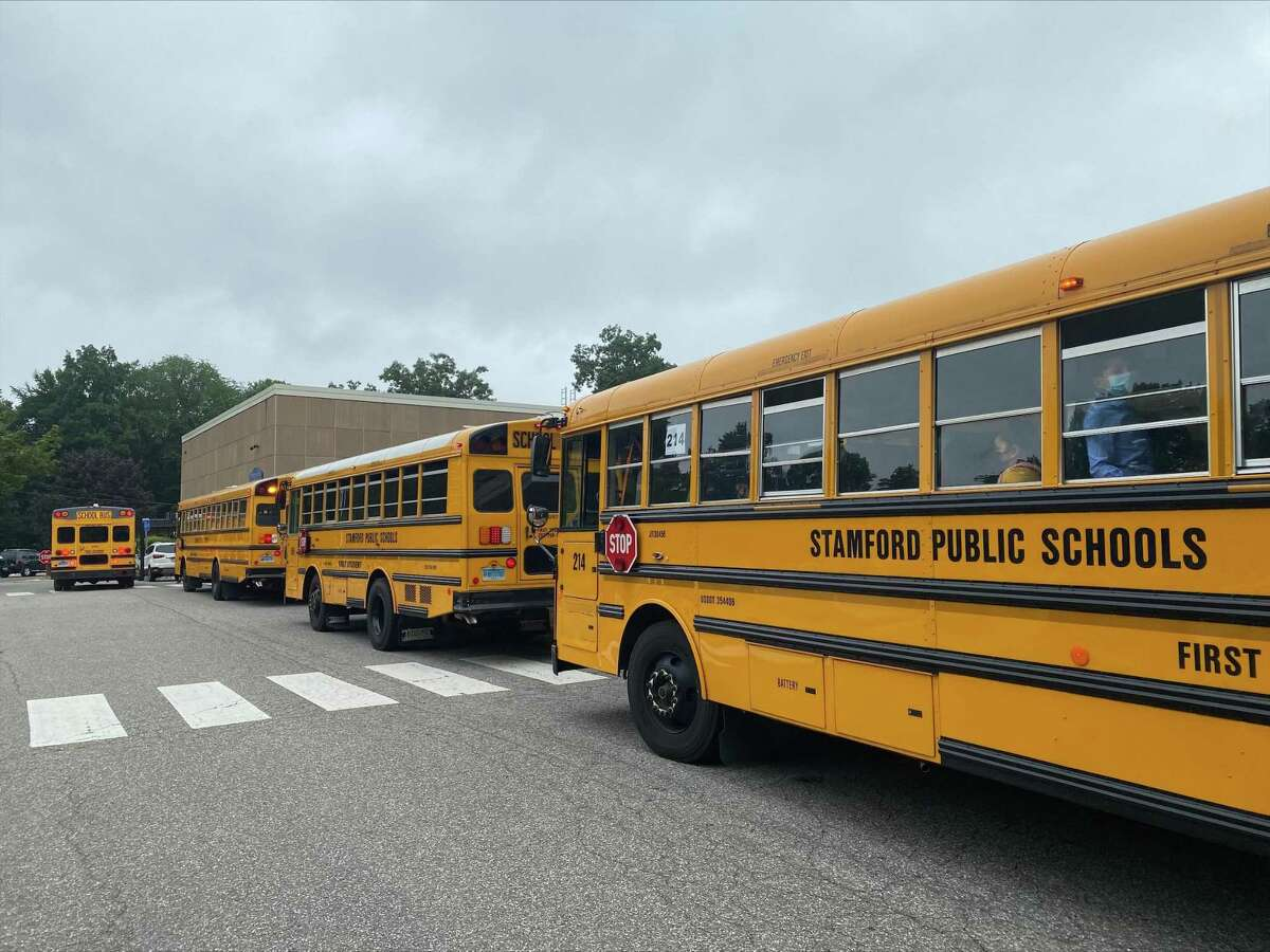 Buses pull into the lot at Newfield School on the first day of school in Stamford.