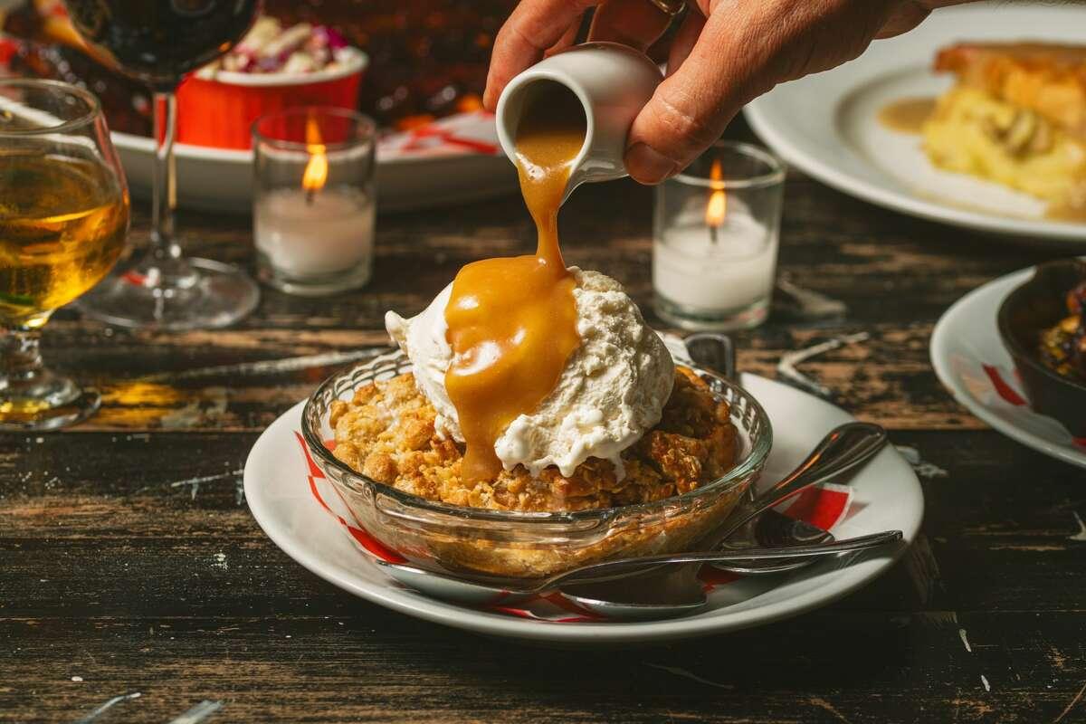Apple crisp with vanilla ice cream and caramel drizzle.