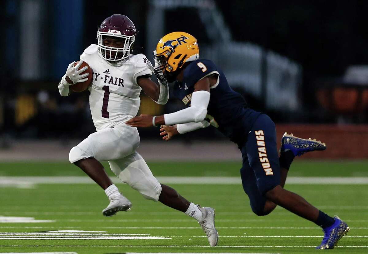 Cy-Fair Bobcats wide receiver Zaccheas Baynes (1) runs the ball defended by Cypress Ranch Mustangs on Thursday.
