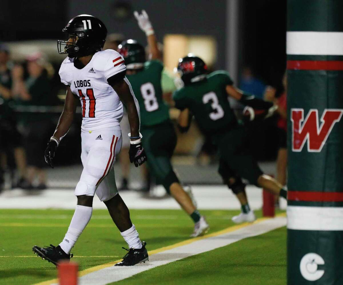 Langham Creek wide receiever/defensive back Jaquaize Pettaway (11) walks off the field after a pass intended for him was intercepted by The Woodlands linebacker Evan Dubin to give the Highlanders a 48-42 win over the Lobos during the fourth quarter of a non-district high school football game at Woodforest Bank Stadium, Thursday, Aug. 26, 2021, in Shenandoah.