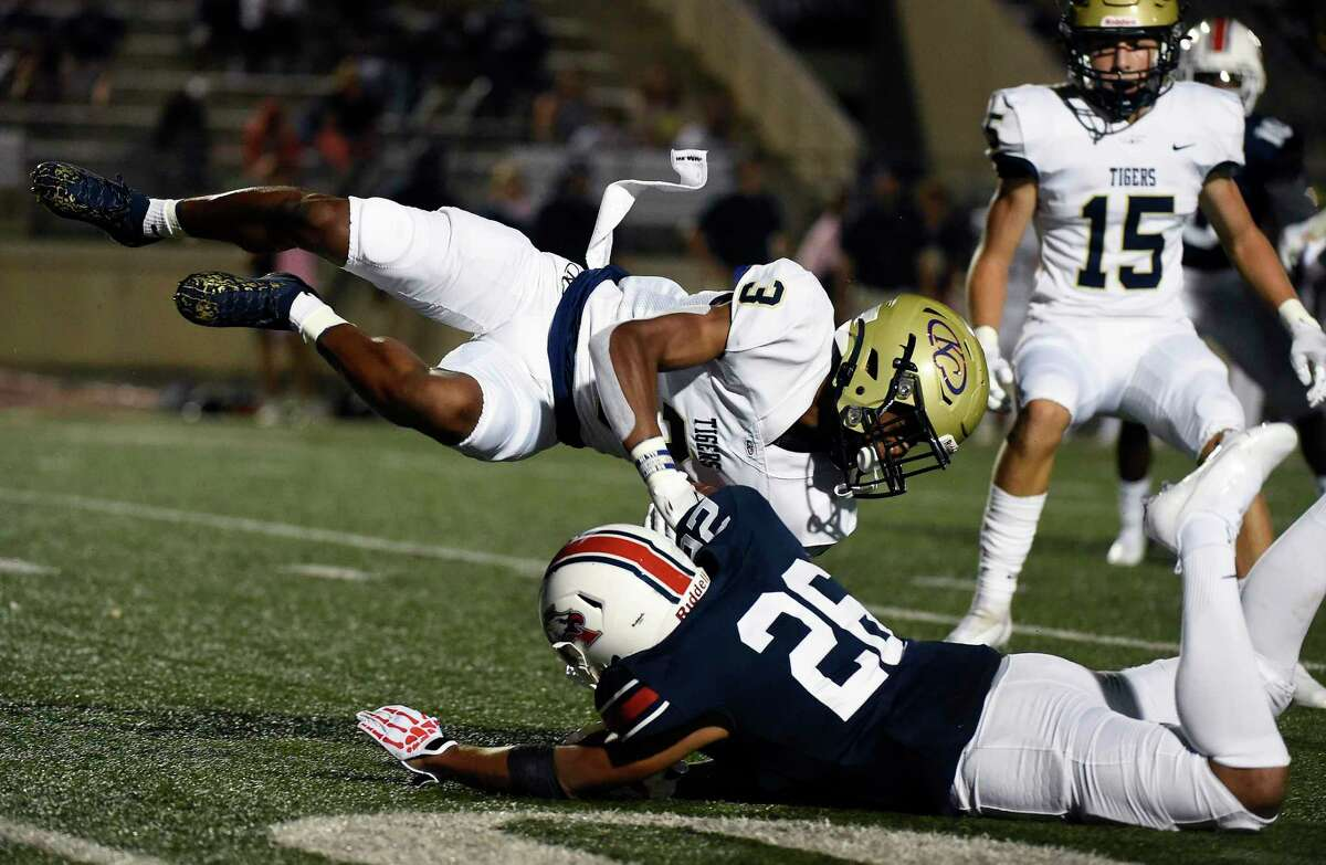 Klein Collins kick returner Marquel Allen (3) is tackled by Atascocita's De'Angelo Hayes during the first half of a high school football game, Thursday, Aug. 26, 2021, in Humble.