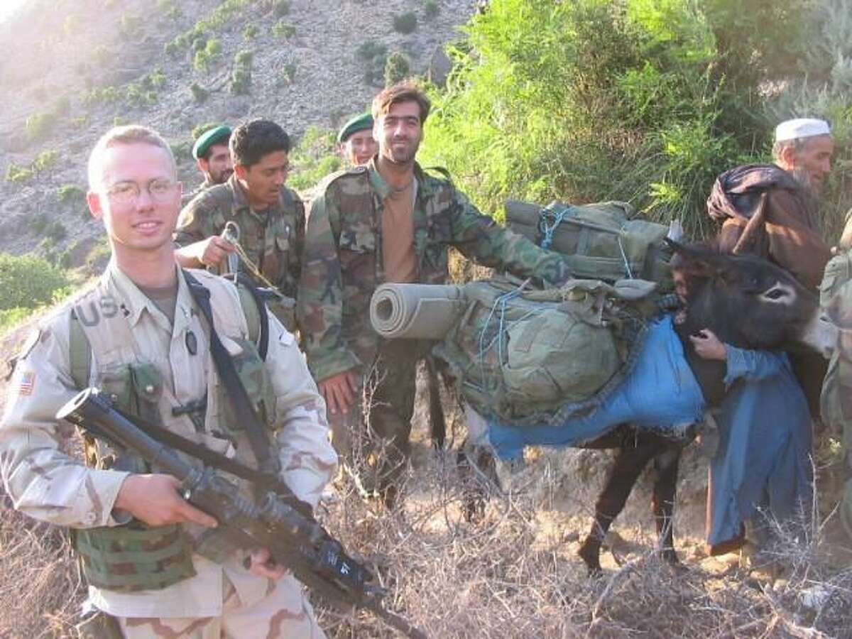 U.S. Army Capt. Mike Kuszpa (forefront) of New Haven on a patrol in the Pech Valley, Kunar Province.