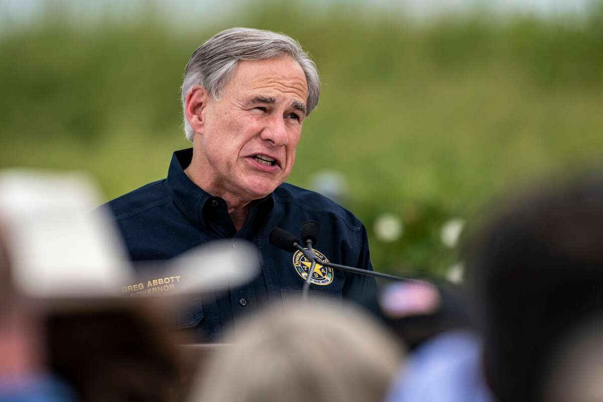 Texas Governor Greg Abbott speaks during a visit to the border wall near Pharr, Texas on June 30, 2021. - Former President Donald Trump visited the area with Texas Gov. Greg Abbott to address the surge of unauthorized border crossings that they blame on the Biden administration's change in policies. (Photo by Sergio FLORES / AFP) (Photo by SERGIO FLORES/AFP via Getty Images)
