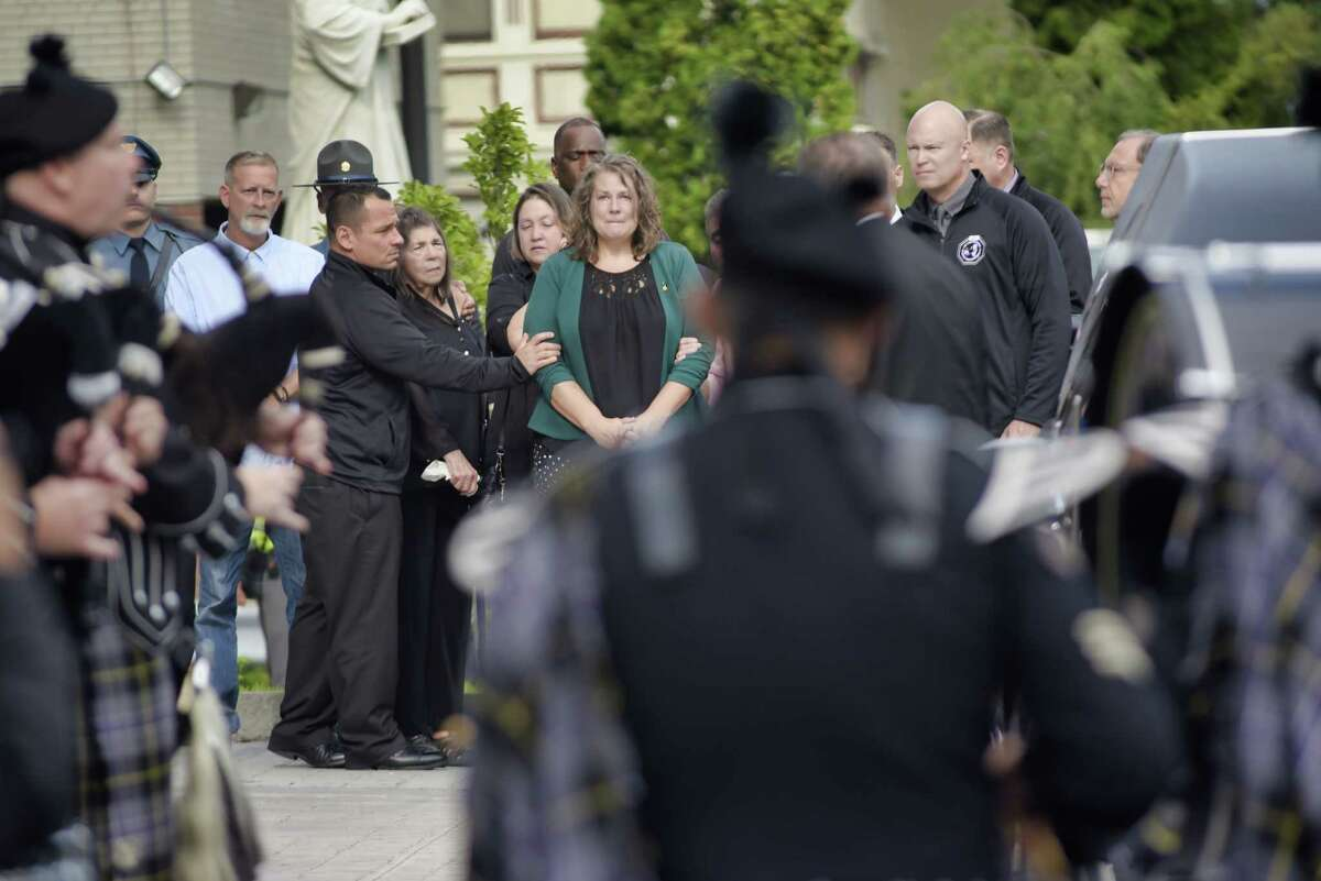 Family members of New York State Trooper James Monda arrive at St. John the Evangelist Church for his funeral on Monday, Aug. 30, 2021, in Schenectady, N.Y. Monda died Aug. 22 in Great Sacandaga Lake.