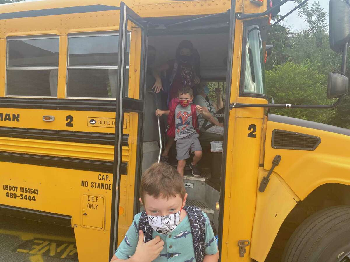 Students get off the bus for the first day of school in Sherman on Aug. 30.
