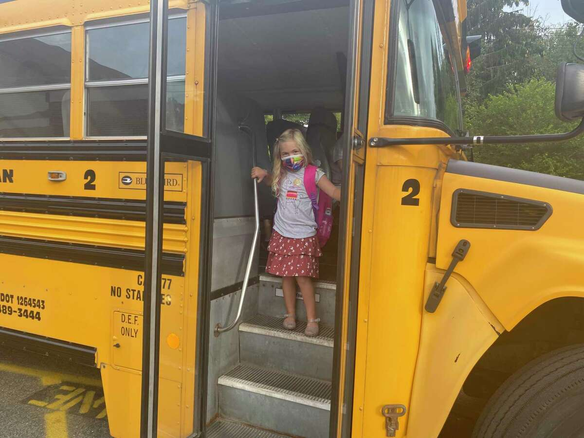 A student comes of the bus on the first day of school at The Sherman School.