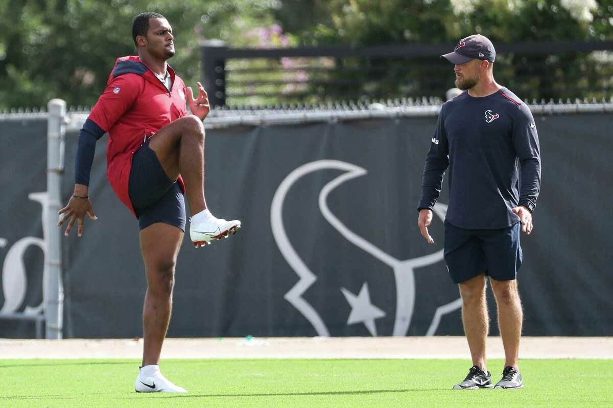 Houston Texans quarterback Deshaun Watson works out on the side during an NFL training camp football practice Thursday, Aug. 19, 2021, in Houston.