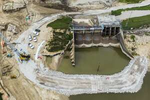Work continues on the Edenville Dam on Friday, Aug. 6, 2021 in Gladwin County. The dam was been breached Tuesday, May 19, 2020 after days of heavy rain, which accumulated in Wixom Lake. (Adam Ferman/for the Daily News)