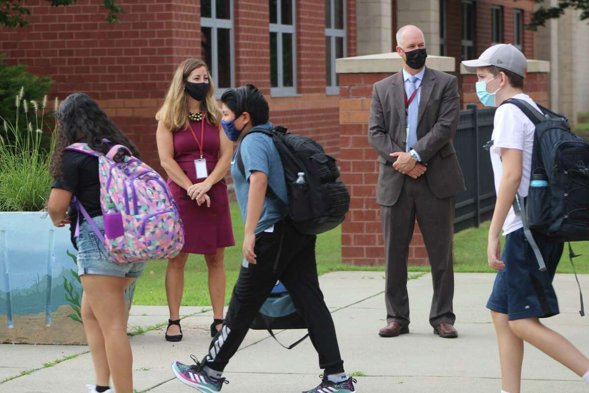 East Lyme Middle School students returned to school on Monday, Aug. 30 and were greeted by staff, including Superintendent Jeffrey Newton.